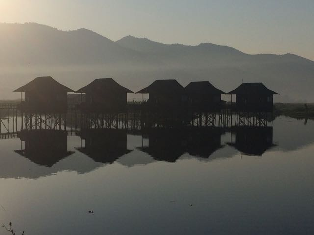 Inle Lake boat tour sunrise shadows